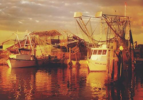 Shrimp boats at sunset in Bayou La Batre Alabama
