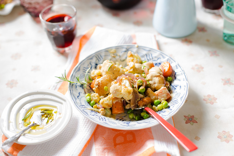 Roasted Cauliflower, Potato and Peas with Garlic Tahini Dressing