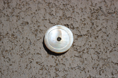 Look what I excavated from our garden: A vintage Mother of Pearl button
