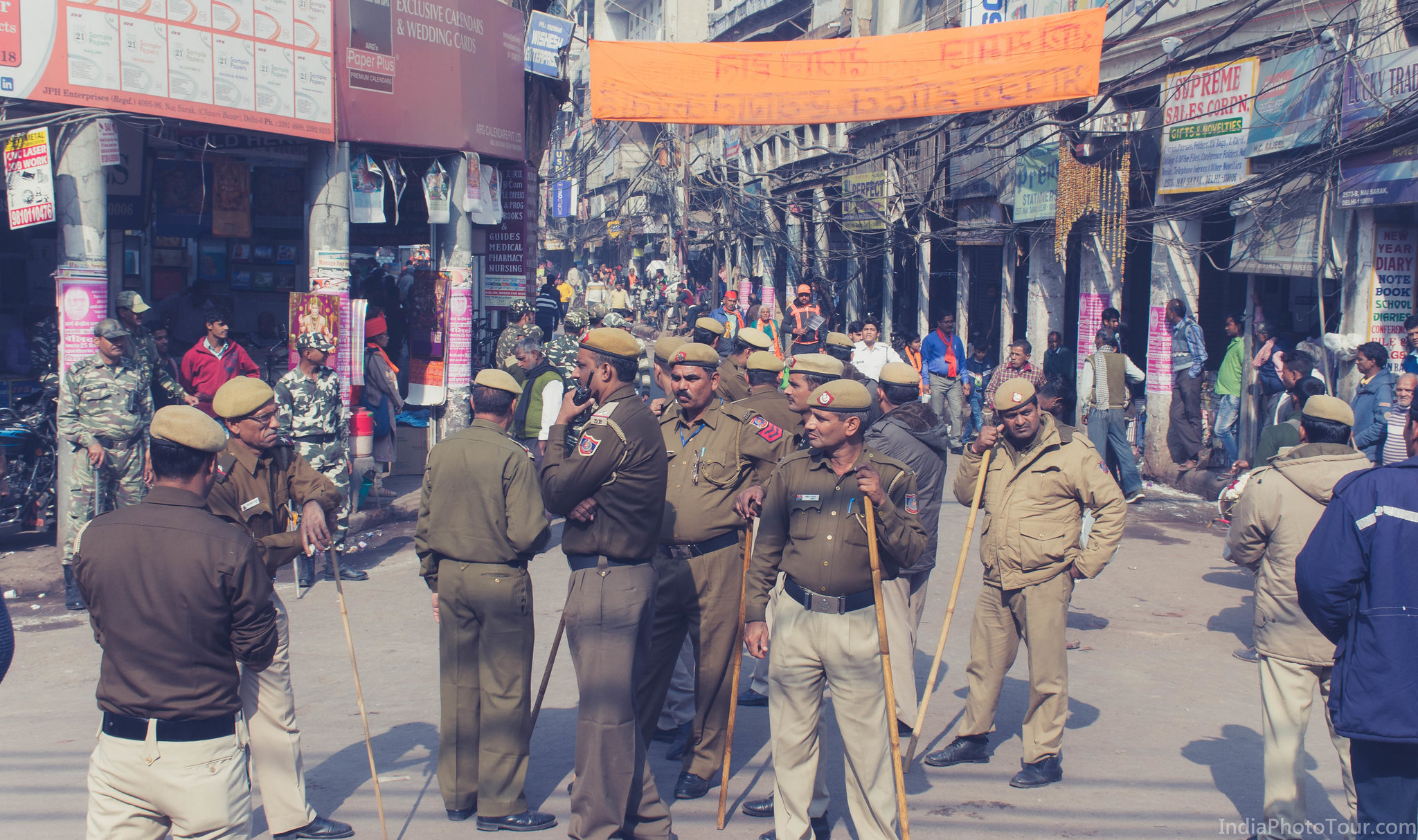 Policemen keeping a watch on crowd and traffic during a street procession