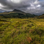12. September 2016 - 9:53 - Returning to Capel Curig in Snowdonia following the path. The shapely peak of Moel Siabod emerging from the gloomy cloud that had been covering it most of the day & some welcome patches of sunlight letting me shrug of the Waterproofs.