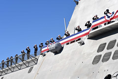 Sailors aboard USS Omaha (LCS 12) salute as they man the rails during the ship's commissioning ceremony, Feb. 3. (U.S. Navy/MC1 Melissa K. Russell)