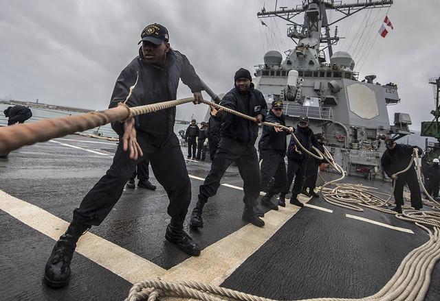 Sailors haul in mooring lines as the ship departs Varna, Bulgaria.