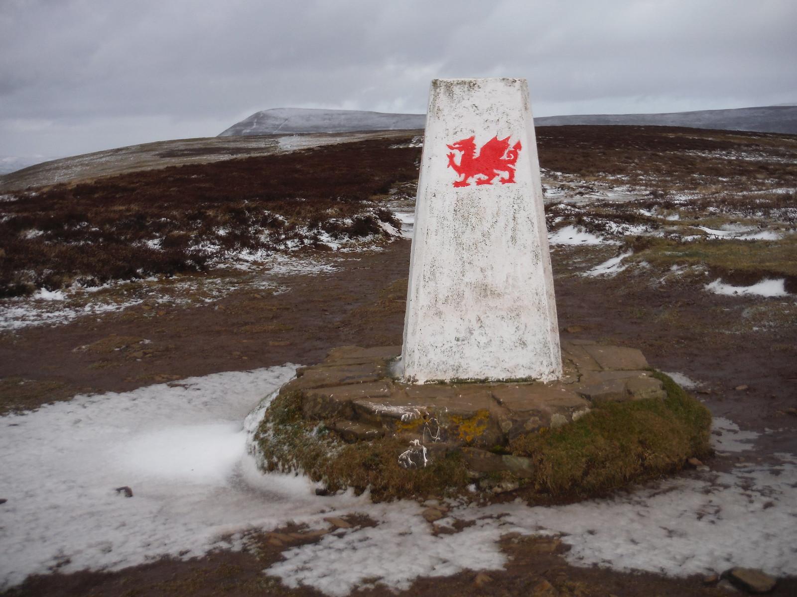 Trig Point on Mynydd Llangorse, with Mynydd Troed in distance SWC Walk 308 - Bwlch Circular (via Mynydd Troed and Llangorse Lake)