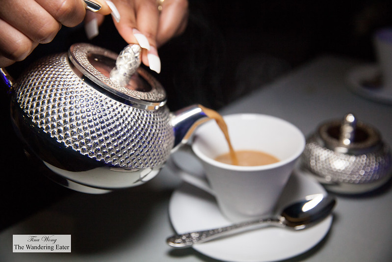 House made chai tea served in silver teaware from India