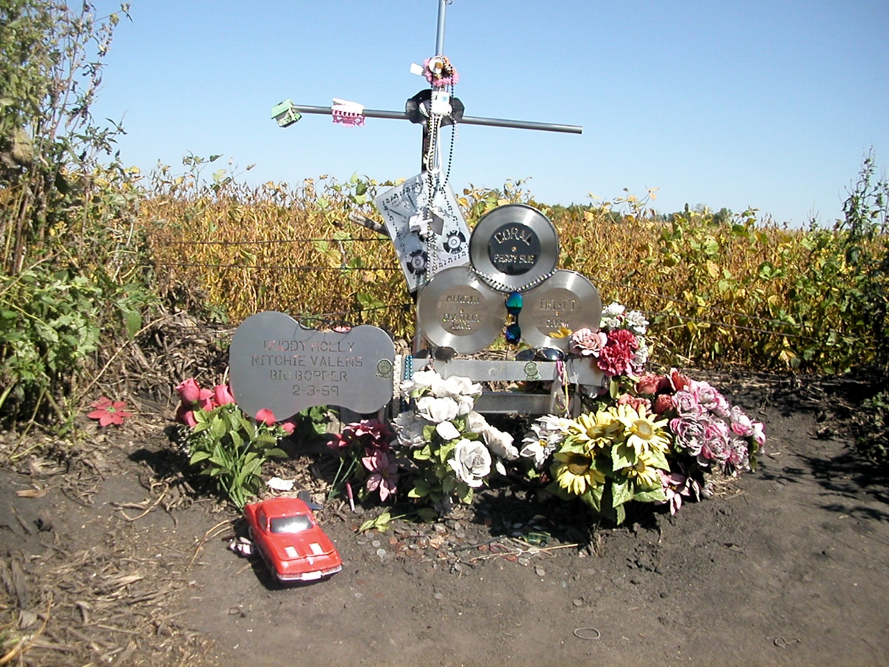 Monument to Buddy Holly, Ritchie Valens and J.P. Richardson, located approximately eight miles north of Clear Lake, Iowa. The small memorial is located at the place the plane came to rest. Four trees were also planted along the fence row in 1999, one for each performer and the pilot. Photo taken on September 16, 2003.