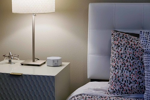 Bed, side table, lamp and white noise machine
