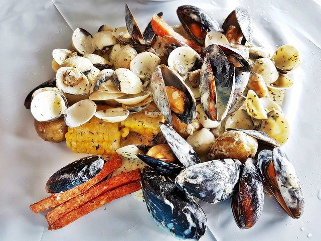 Flexing Mussels & Clams With Herb & Butter