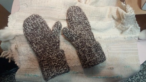 crocheted mittens before wet finishing (my first)