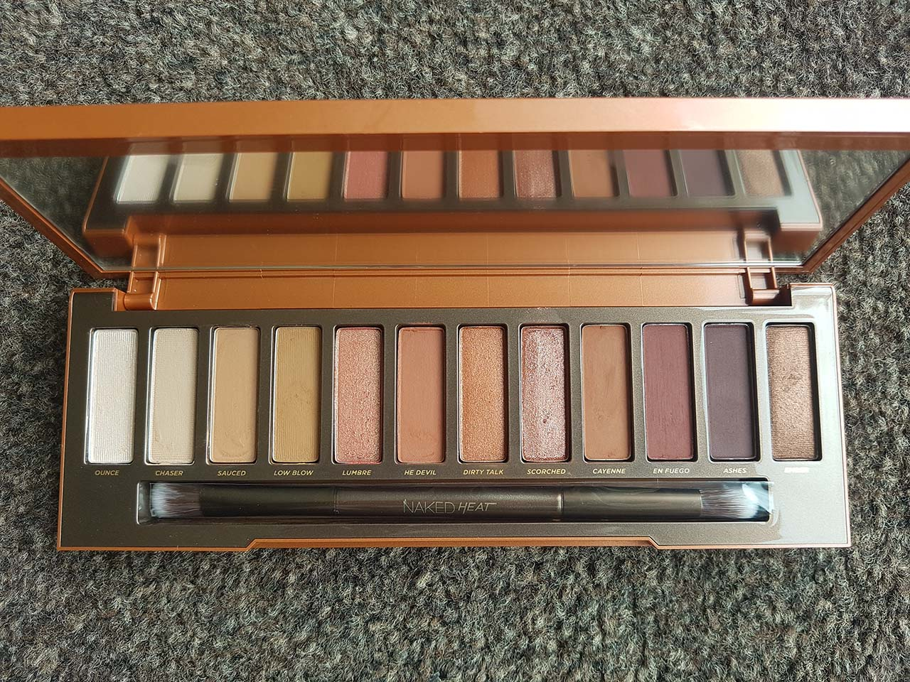 Urban Decay's Naked Heat Palette: A Hot Addition to the Naked Collection - Naked Heat Palette - Inside the sleeve, the palette casing was equally lovely. It is slightly holographic and again captures the colours contained within. I also loved the matchstick imagery in the bottom of the box.