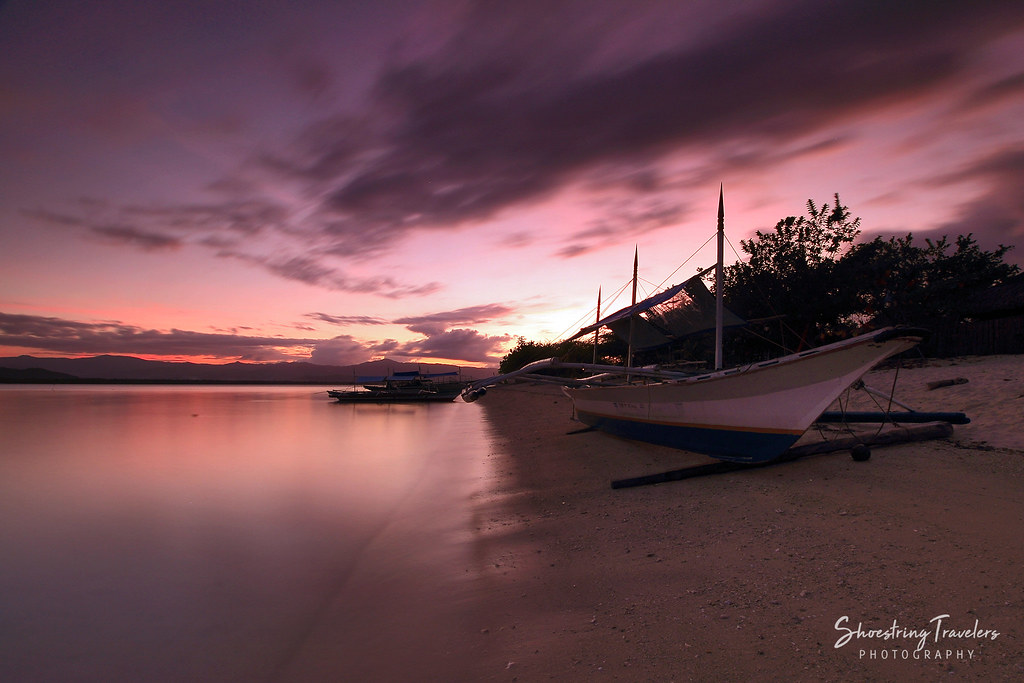 sunset at the western beach of Maniwaya Island