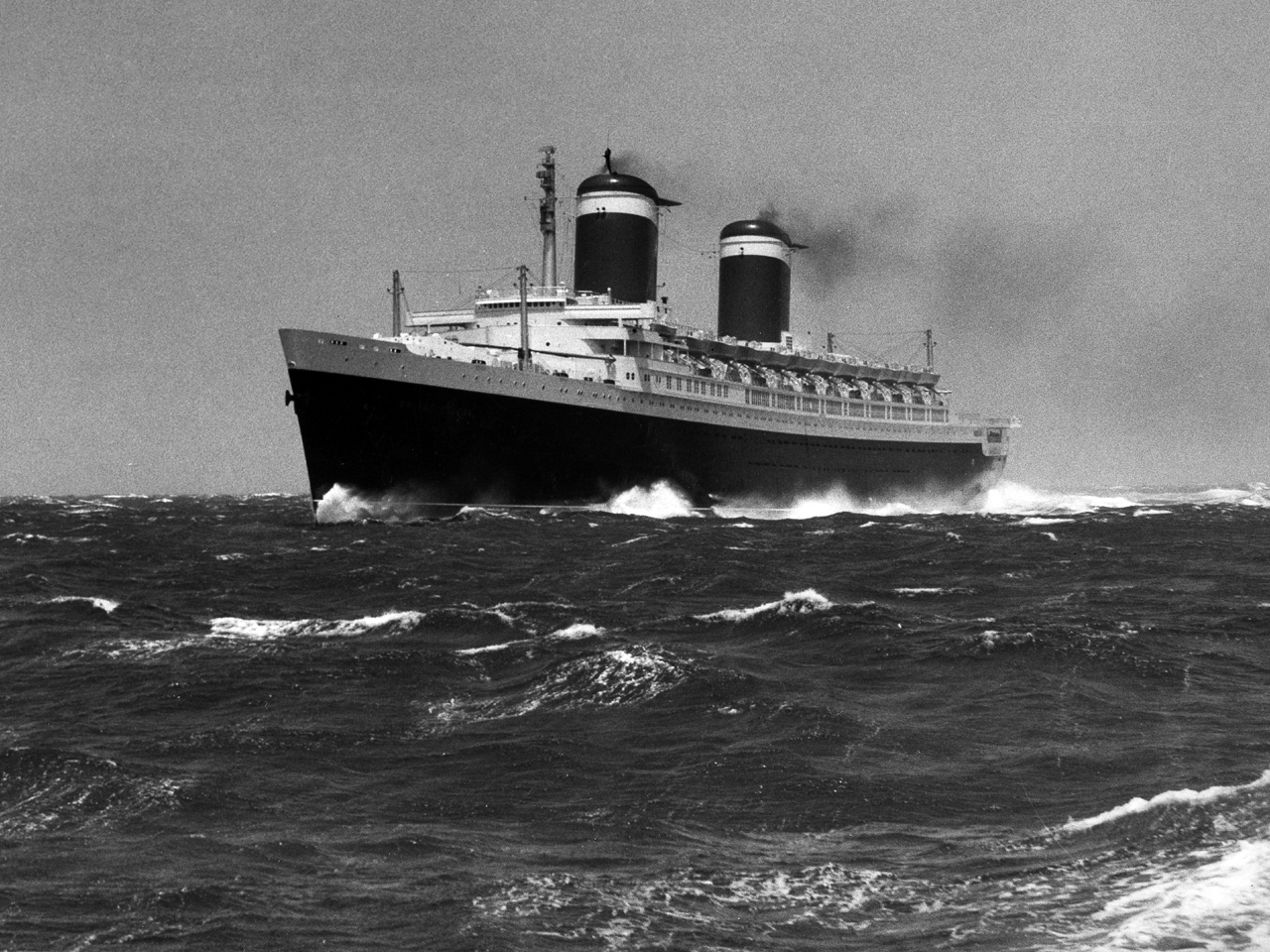 The majestic SS United States cuts through choppy seas with ease.