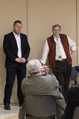 Rep. Joe Polletta and Rep. Dave Wilson listen to a constituent during an open Q&A session at the Woodbury Senior Center to discuss the upcoming 2018 legislative session.