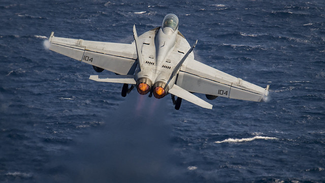 """SOUTH CHINA SEA (Feb. 23, 2018) An F/A-18F Super Hornet assigned to the """"Bounty Hunters"""" of Strike Fighter Squadron (VFA) 2 takes off from the flight deck of the aircraft carrier USS Carl Vinson (CVN 70). Carl Vinson Strike Group is currently operating in the Western Pacific as part of a regularly scheduled deployment. (U.S. Navy Photo by Mass Communication Specialist 3rd Class Matthew Granito/Released)"""