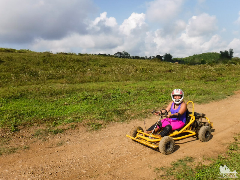 Sweetie looks cute driving an off-road go-cart