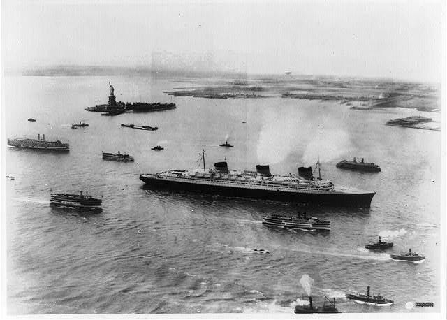 SS Normandie arrives in New York harbor following her maiden westbound transatlantic voyage on June 3, 1935.