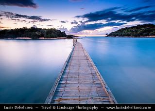 Albania - Albanian Riviera - Ksamil beach and its wooden pier at Dusk