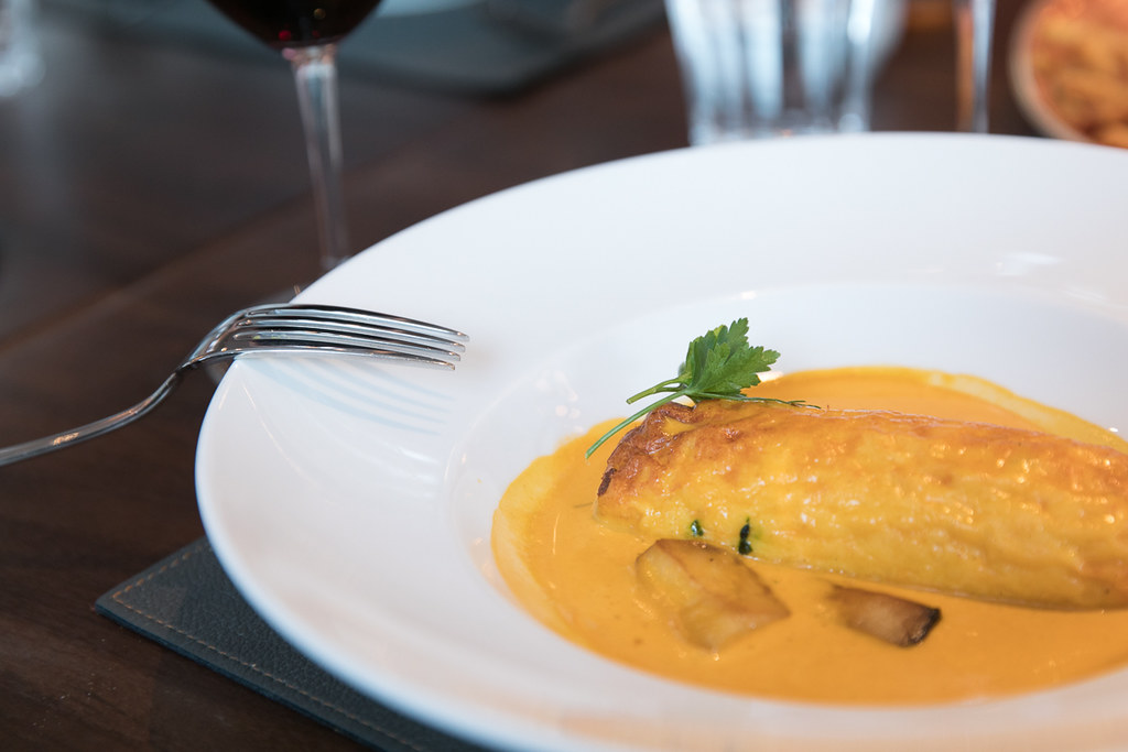 Lyon-style northern pike quenelle with nantua sauce and pilaf rice
