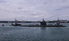 SINGAPORE (Feb. 14, 2018) The Los Angeles-class attack submarine USS Bremerton (SSN 698) pulls in to Changi Naval Base for a port visit to strengthen partnerships and a chance for crew rest. Bremerton is on a regularly scheduled deployment to the Indo-Pacific region. (U.S. Navy photo by Mass Communication Specialist 3rd Class Christopher A. Veloicaza)