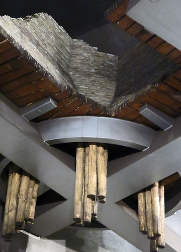 Waiting for the train in the Rotterdam station I spotted these unique wood 'sculptures' breaking through the ceiling