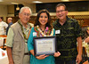 Hawai'i Community College 2018 Alumna of the Year Lacy Deniz, center, was honored during a Hawai'i CC Alumni & Friends event on February 8. At right is Hawai'i CC Alumni & Friends President Bobby Yamane and at left is Harold Nishimura, who was the Hawai'i Community College 2017 Alumnus of the Year.