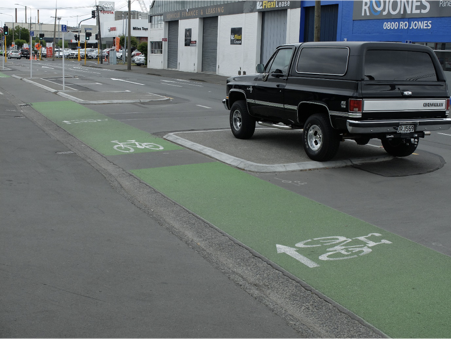 Enforcement and education are fundamental components of Vision Zero. This vehicle has been parked in such a way that vehicles crossing the cycleway cannot see people on bikes (St Asaph Street cycleway, Christchurch, November 2017).