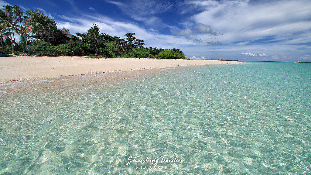 white sand and crystal-clear turquoise waters at Kota Beach