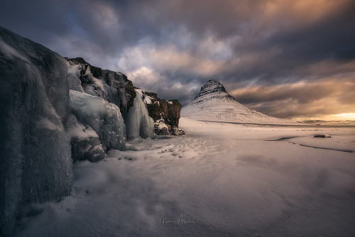 iceland darkness drama enchanting lightdrama magic caves ice mountainpeaks mountainslope mountains rocks stones cascade frozen river snow water waterfall clouds glow morning sunrise kirkjufell