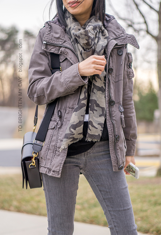 gray military jacket, camo printed scarf, black twist front top, gray skinny jeans, black shoulder bag