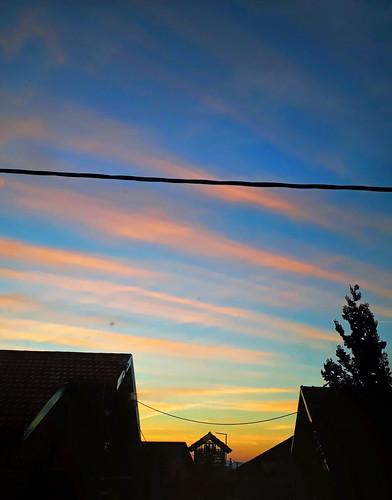morning sky blue yelow red colour winter dawn sunrise clouds petrinja croatia hrvatska balkans balkan eu europe european tree roof houses shadow shadows outdoors outside