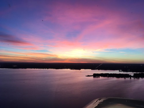 flight generalaviation flying universityofmichiganflyers cessna 152 michigan lakeerie sunset clouds grosseile