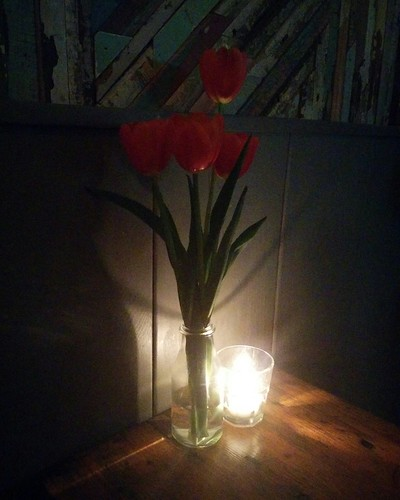 Red tulips and candle #toronto #greatergood #gearyave #davenport #red #tulips #flowers #candles #latergram