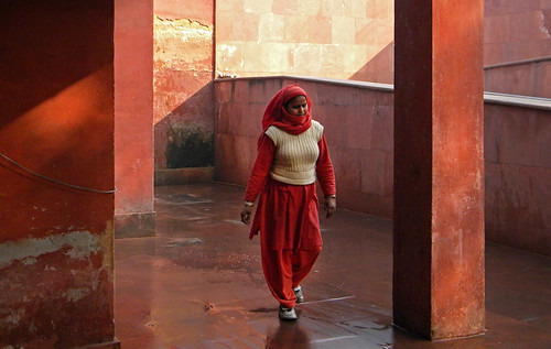 Woman in red in the Red Fort in Delhi, India