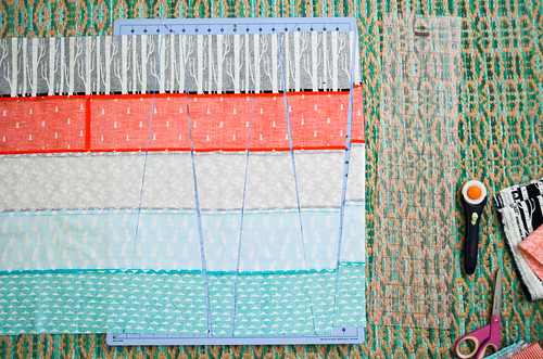 """1. Cut prints into 5"""" strips, sew together in groups of 5, cut wedges (in alternating directions)."""