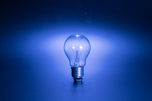 Single light bulb on a blue background