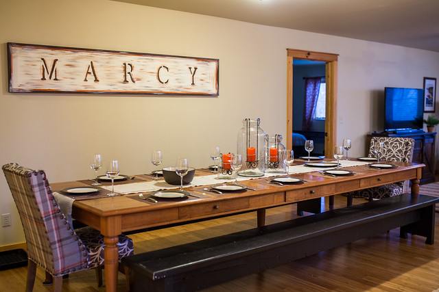 Marcy offers a buffet style dining table that easily seats 12 with additional seating in the kitchen area;