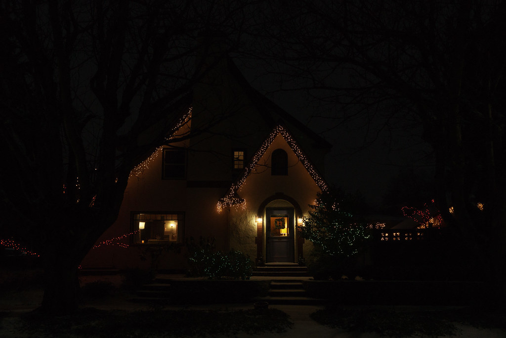 A house is tastefully lit with Christmas lights in the Irvington neighborhood of Portland, Oregon
