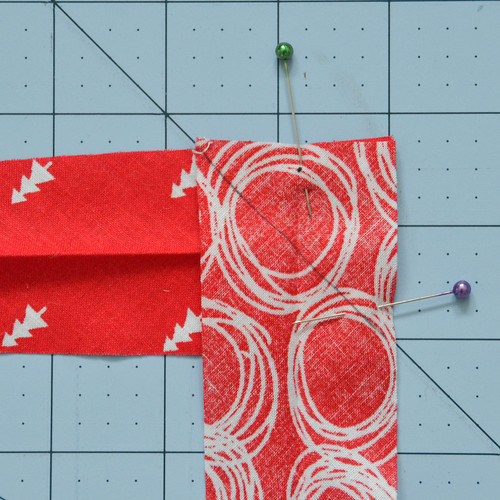 Pin and sew a 45 degree seam from the upper left corner of the top fabric, to the lower right corner of the bottom fabric.