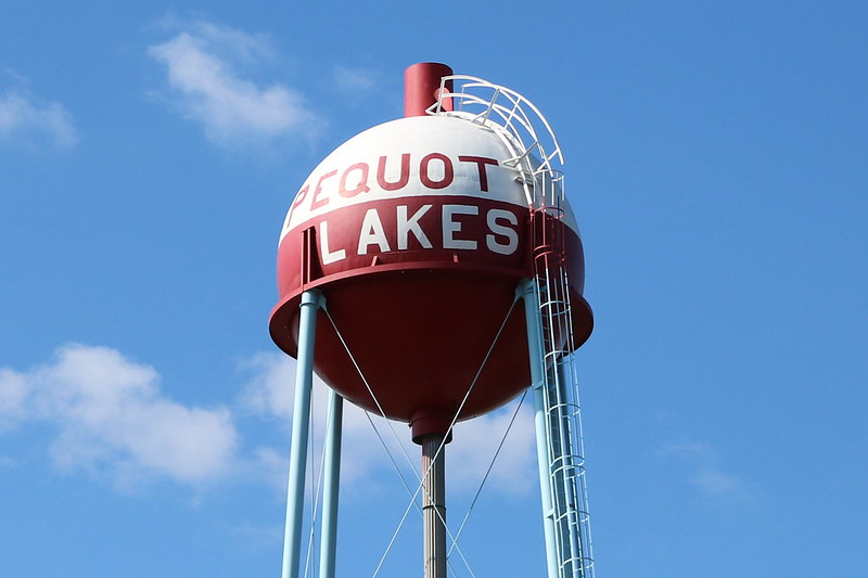 red-and-white bobber-shaped water tower