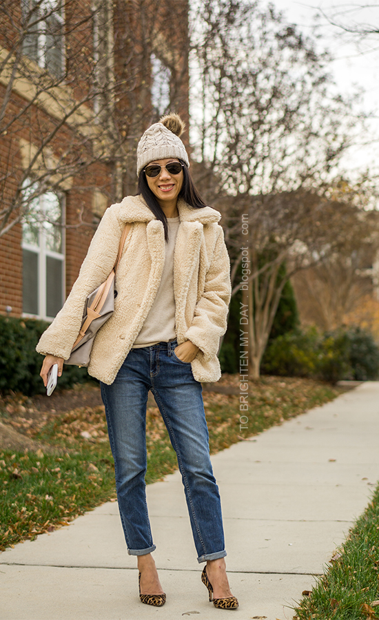 beanie with pom pom, sherpa teddy coat, camel cashmere sweater, girlfriend jeans, leather and canvas tote, leopard pumps