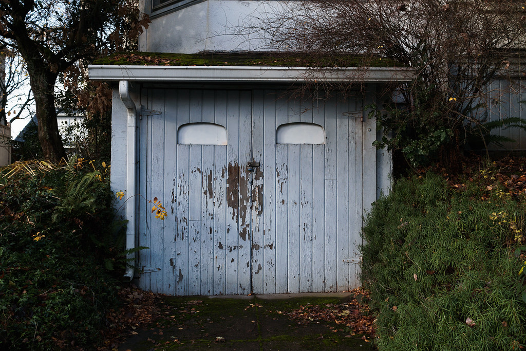 An old weathered garage appears to be smiling in the Irvington neighborhood of Portland, Oregon