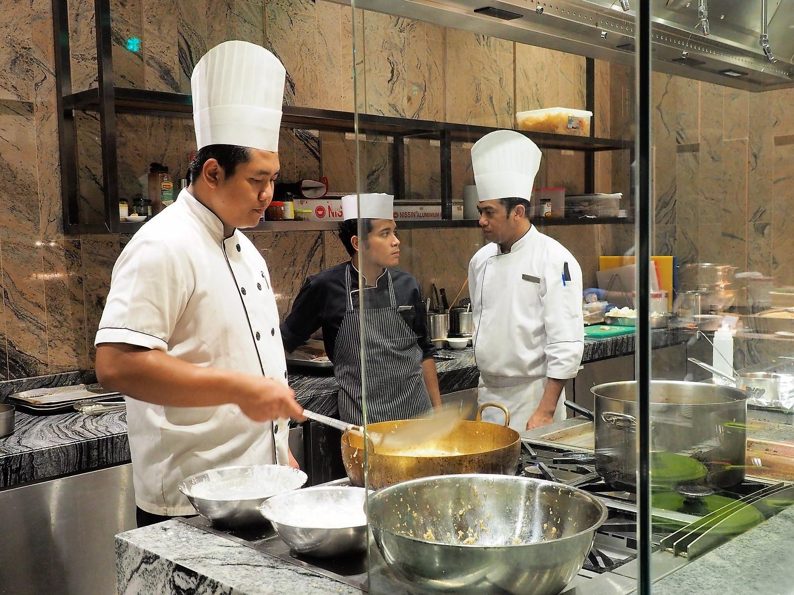 Chef preparing more food