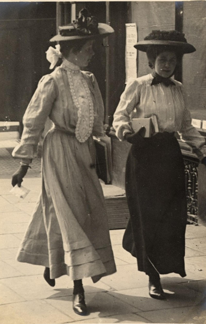 Two women talking carrying books, 1908