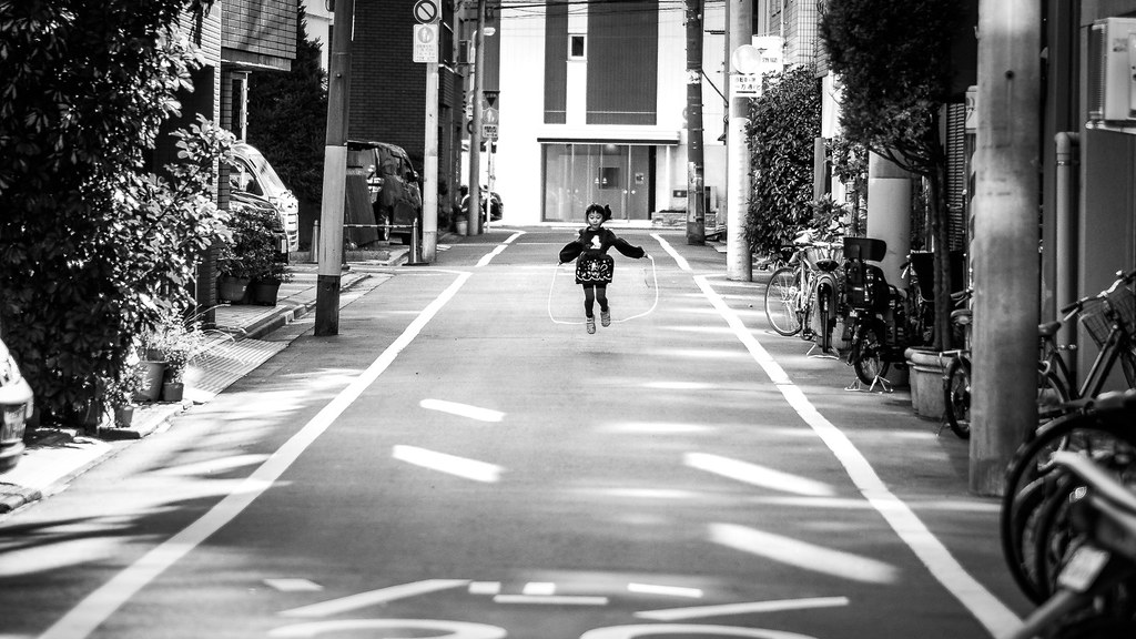 Happiness - Tokyo, Japan - Black and white street photography