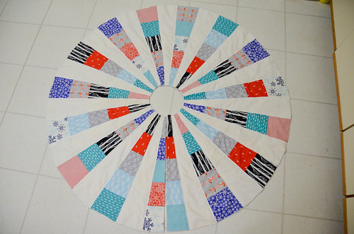 17. Trim quilt. Cut line between formerly-overlapping wedges. Cut out circles in the middle of quilt top.