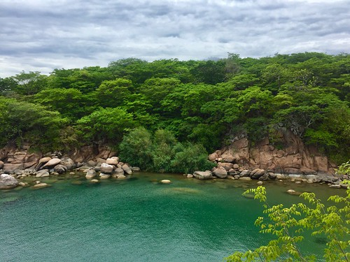 Cape Mac Lear, Thumbi, Mumbo Island, Lake Malawi's Ecotourism Paradise, Lake Malawi National Park, Malawi Mumbo Island is a tropical island floating on the expansive waters of the Lake Malawi National Park and surrounded within massive underwater boulders