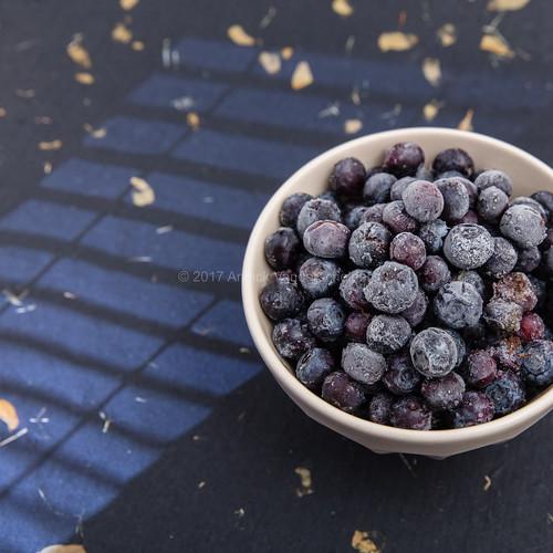 Frozen blueberries in a bowl.