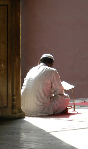 Man studying at the Jama Masjid Mosque in Delhi India