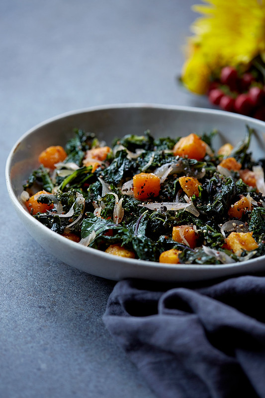 Wilted Kale Salad with Warm Mustard Shallot Vinaigrette and Spicy Butternut Squash