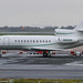 N900SN - 2002 build Dassault Falcon 900EX, parked remote to the main Signature apron at Manchester